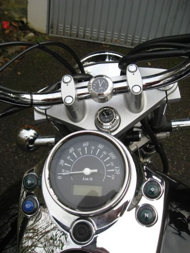"Picture 27: My motor-bike ""SUZUKI Intruder 125"" / viewed  from above - speed indicator, clock and thermometer"