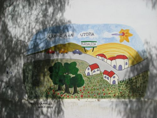 "Picture 6: Graffiti ""On the road to the utopia"" in Marinaleda"